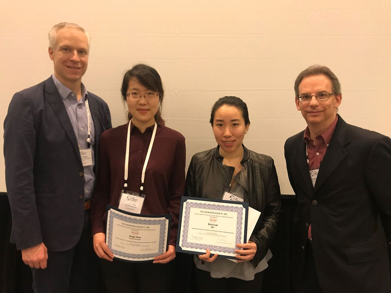 Professor Al Crosby (left) and Henkel's Eric Silverberg presented the awards at the annual meeting of the Adhesion Society to (L to R) Jingyi Guo and Erika Lai.