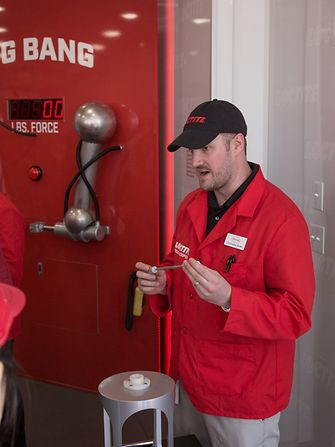 "Henkel's Chris Burke facilitates the Loctite ""Big Bang"" demo showing the incredible bond strength of LOCTITE hybrid adhesives."