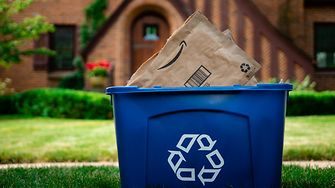 EPIX™ expands paper functionality and improves performance while maintaining the sustainability and recyclability of the package - a blue recycling bin with discarded paper envelopes