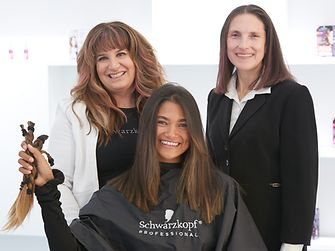 Volunteer Henkel employees, friends and family members received haircuts from Henkel stylists, all donating their hair to commemorate Breast Cancer Awareness Month.
